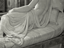 Pauline Bonaparte as Venus Victrix (or Venus Victorious). Nude portraits were unusual, subjects of high rank usually having strategically placed drapery. It is a matter of debate as to whether she actually posed naked for the sculpture, since only the head is a realistic (if slightly idealised) portrait, whilst the nude torso is a neo-classically idealised female form. When asked how she could pose for the sculptor wearing so little, she reputedly replied that there was a stove in the studio that kept her warm, though this may be apocryphal or a quip deliberately designed by her to stir up scandal.
