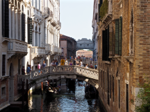 The bridge in the background is the famous Ponte dei Sospiri, the Bridge of Sighs